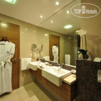 Фото отеля Majestic Ajaan by Rotana 4*