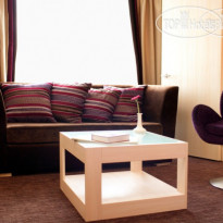 Фото отеля Ramada Donetsk 4* Business-Suite sitting room