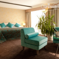 Фото отеля Ramada Donetsk 4* Suite Bed Room