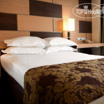 Фото отеля Ramada Donetsk 4* King bed eccessible room