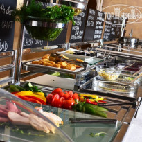 Фото отеля Ramada Donetsk 4* Buffet table