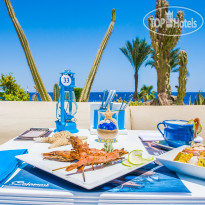 Фото отеля Renaissance Sharm El Sheikh Golden View Beach Resort 5* Delightful seafood at Calamari Seafood Restaurant.