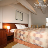 Фото отеля Red Brick Apartments 4*
