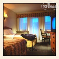 Фото отеля Four Points by Sheraton Hotel & Suites Calgary West 4*