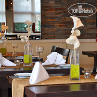 Фото отеля Top Hotel am Bruchsee 3*