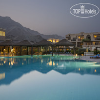 Miramar Al Aqah Beach Resort 5* Outdoor Pool Twilight - Фото отеля