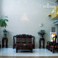 Фото отеля Beijing GuoMen Business Hotel 3*