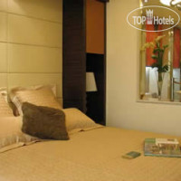 Фото отеля Grand Continental Service Apartment 4*