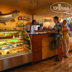 Рестораны и бары Guy Harvey Outpost - A TradeWinds Beach Resort
