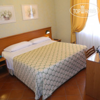 Фото отеля Corona 3* Double bedroom services: wifi , air conditioning, hd flat screen satellite television-pc compatible, desk, luggage rack, wardrobe, safe, direct telephone, bathroom, hair dryer, three types of towels, shower soap and hand soap.