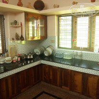 Фото отеля Ganesh House Home Stay кухня