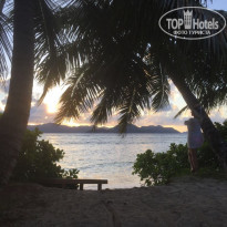 Фото отеля La Digue Island Lodge 4* На закате