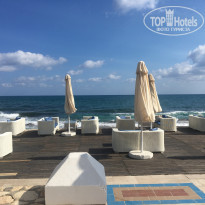 Aldemar Royal Mare Luxury & Thalasso Resort 5* Бар на море - Фото отеля