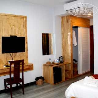 Фото Everland Boutique Hotel