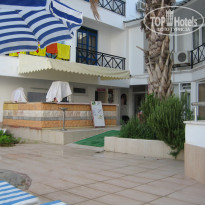 Фото отеля Club Cemar Beach 3* Бар и вход в массажный кабинет